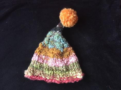 Silly pointy hat with pompom