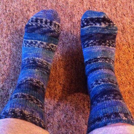 Nikki's hand knit socks on her feet
